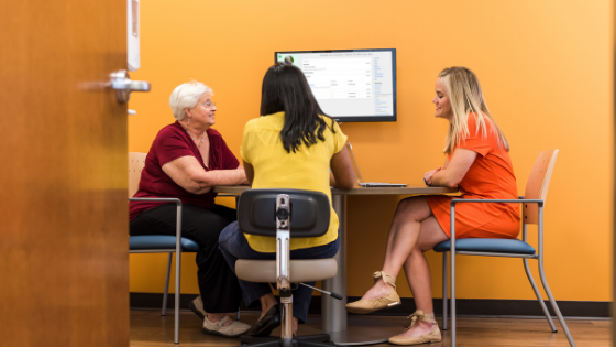 An Iora patients meets with their provider and health coach