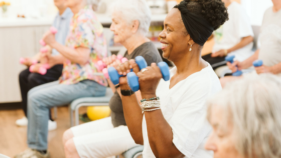 Seniors are seen using dumbbells in an exercise class