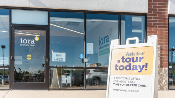 Outside of an Iora practice, a sign reads 'Ask for a tour today!'