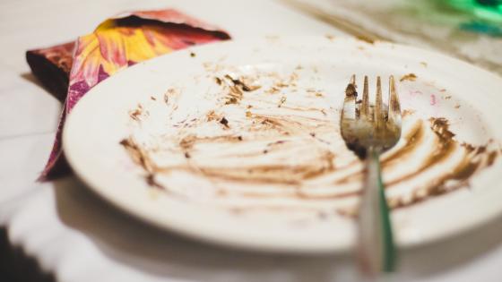 An empty dessert plate and fork