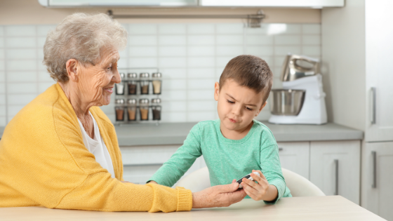 An elderly woman and her young grandson measure her blood sugar levels
