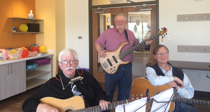 Three Iora Primary Care patients playing music at the doctor's office