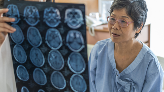 A senior Asian woman looks at the results of a brain scan