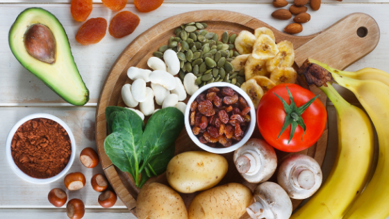 Potassium rich foods like bananas, tomatoes, potatoes, beans, and leafy greens