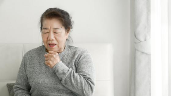 Senior woman struggles to catch her breath