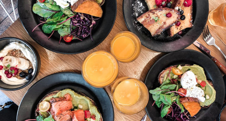 5 nutrient-rich dishes are seen next to 3 glasses of orange juice