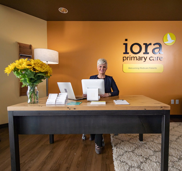Iora Primary Care team member sitting at a desk in the practice