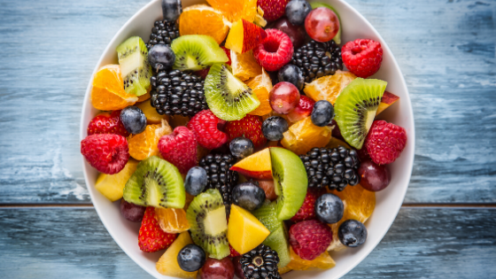 A bowl of fruit salad with citrus and berries