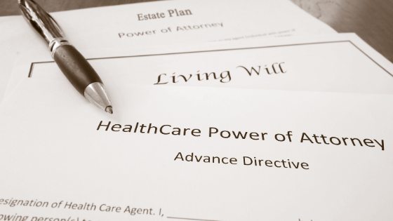 Estate Plan, Living Will, & Advance Directive documents next to a pen