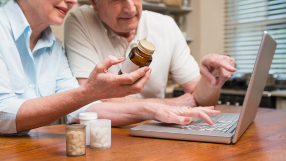 An elderly couple is seen ordering prescriptions online