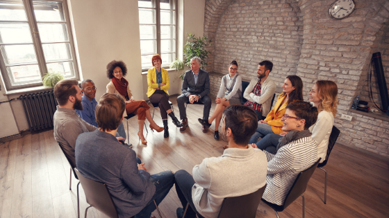A support group sitting in a circle in progress