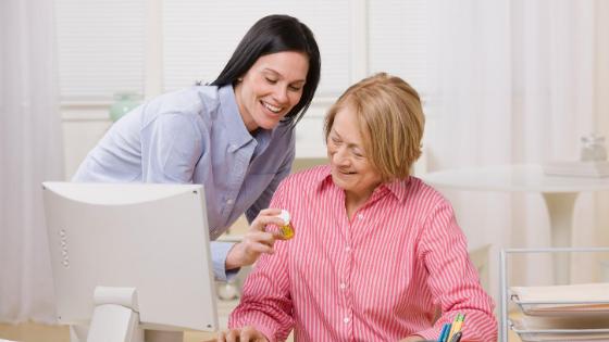 A daughter is seen helper her mother order prescriptions online