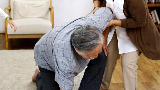 man in blue shirt falling down during a stroke