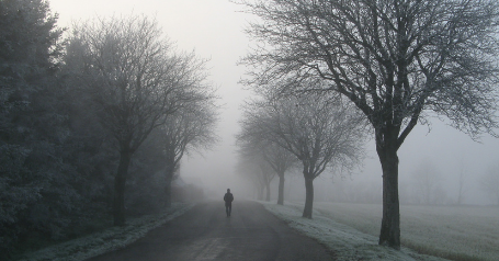lonely person walking down the road