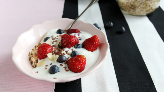 A bowl of lowfat yogurt topped with berries