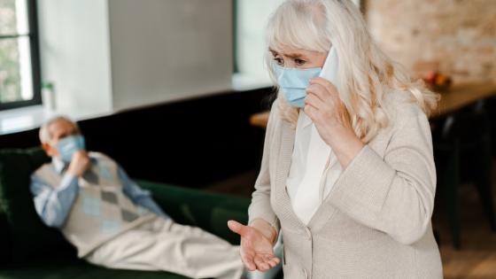 Senior woman wearing mask calling doctor for her spouse