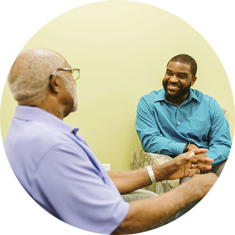 An Iora employee having a discussion with a patient
