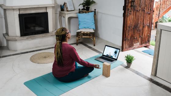 An older woman meditates during a virtual meditation class