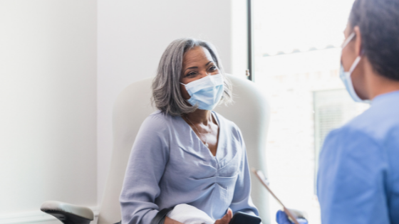 ring a mask sits with her doctor during an apointment
