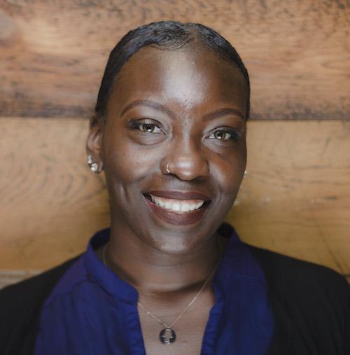 A smiling Iora team member
